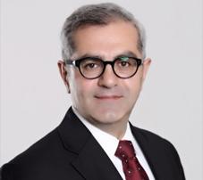 H.E. Dr . Burak Akcapar